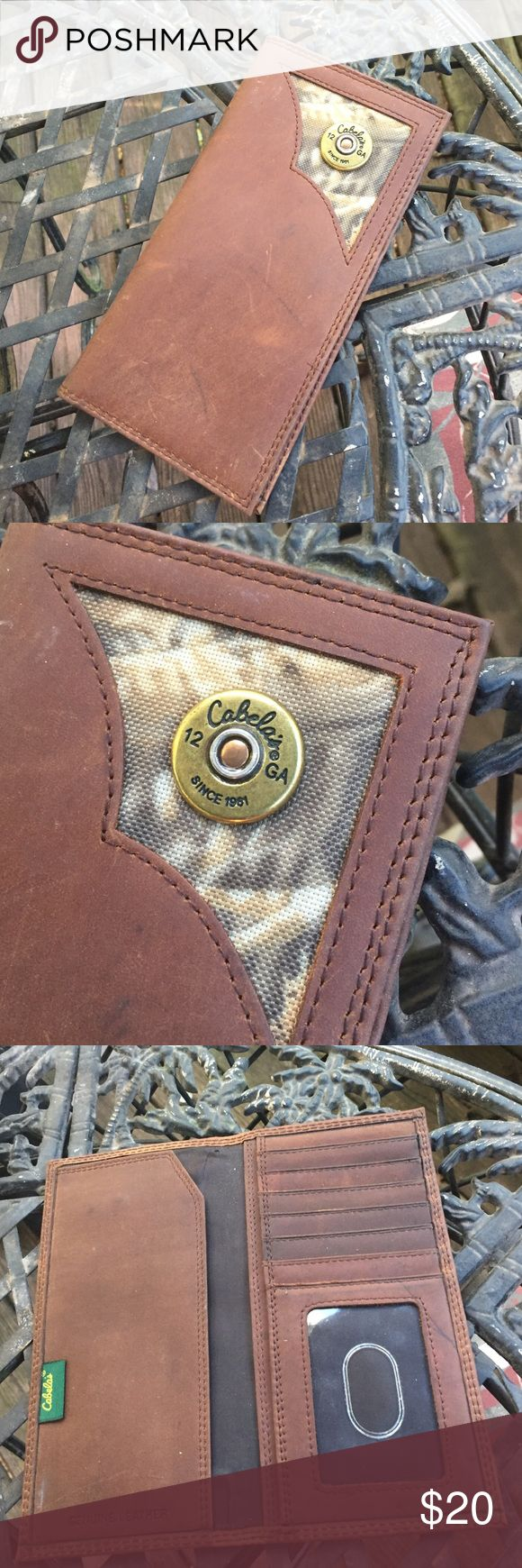 Men's leather checkbook wallet Really good condition. Never used. Just been in my purse for a couple of weeks. He don't like it, so I'm gonna sell it. Cabela's checkbook/wallet. Leather with bullet & camo in corner. Cabela's Bags Wallets