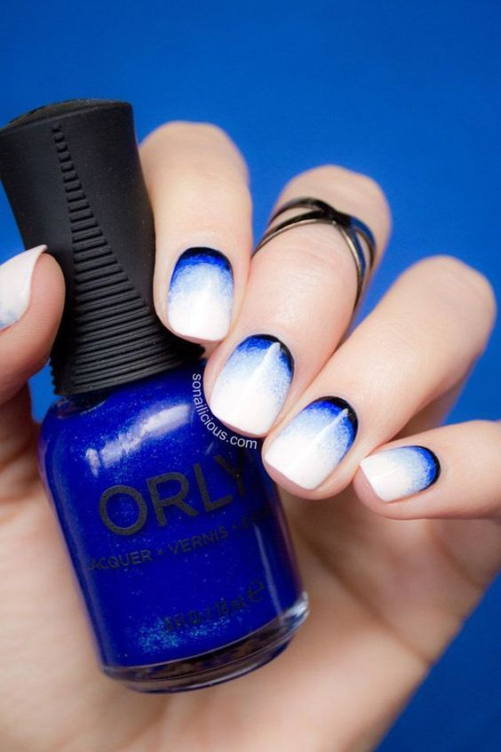 Look at this gorgeous nail art! Inspired with gradients, the nails look like frozen with ice, cool and refreshing amidst the summer heat with the dark blue and sudden white color transitions.: