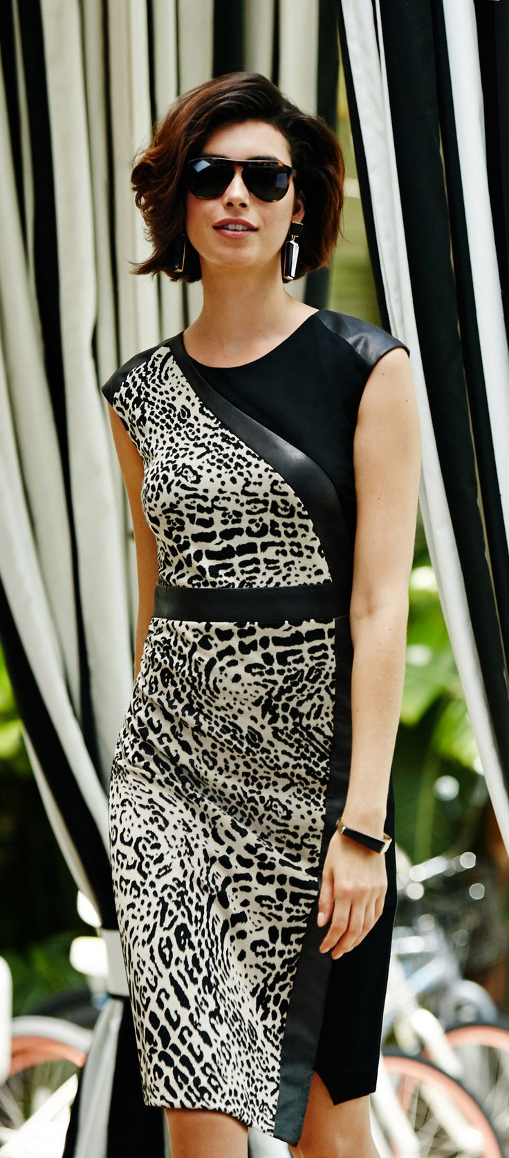 """The """"It"""" Dress. Animal print. Faux leather. Need we say more?"""