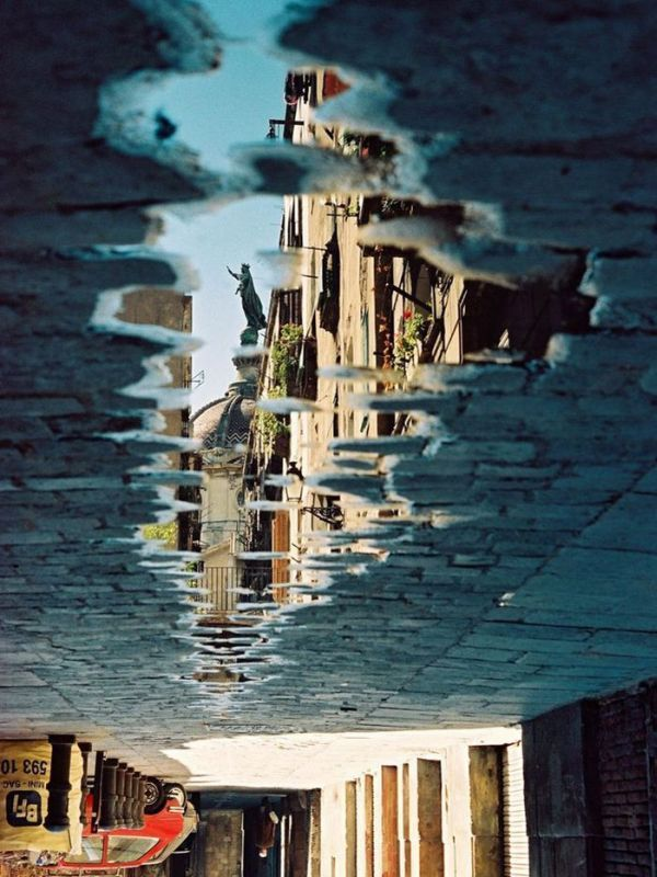 Loving this scene caught in a puddle - it makes a great photograph. (Cannot currently find the source for this image - please let me know if you have it).