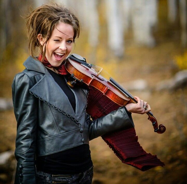 Lindsey Stirling in black leather jacket.