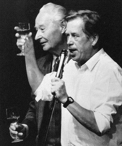 Vaclav Havel, then leader of the Prague opposition (right), and Alexander Dubcek, leader of the ill-fated Prague Spring, toast as they celebrate the resignation of the Czech Polit Bureau on November 24th, 1989.