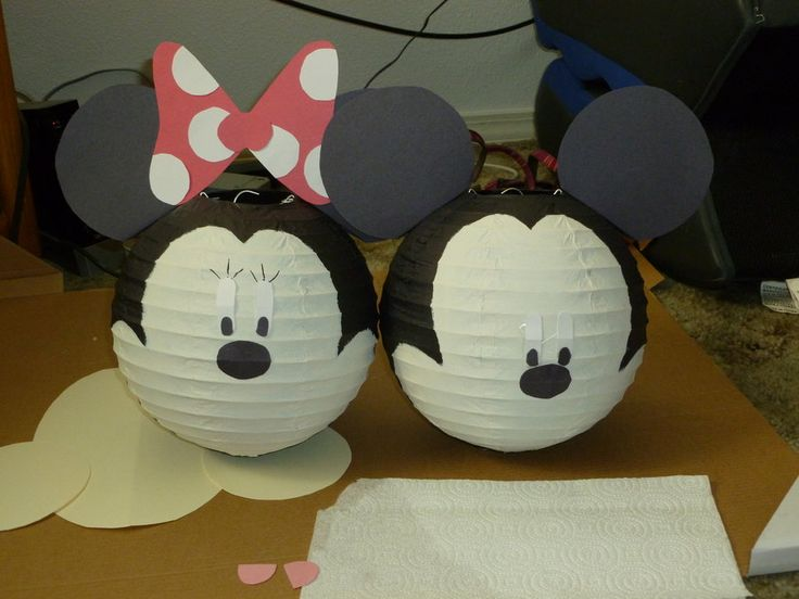 Mickey and Minnie mouse lanterns, like I've been promising and putting off because of school. : x So I started with the black lanterns and all the pieces cut out and tan construction paper for thei...