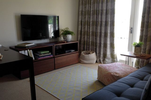 TV moved to mounted wall position, for cleaner look.