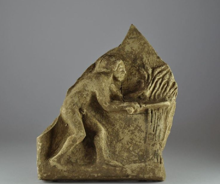 Pinax, 5th century B.C. Greek terracotta relief fragment, pinakes, with man harvesting, 15.9 cm high, unpublished. Private collection