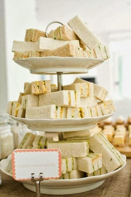 Good idea for mom's birthday party.  Make chicken salad sandwiches and put on 3 tier plate like this.