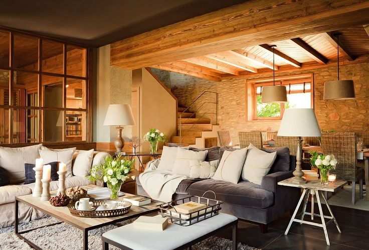 that gray sofa looks so comfy, love all the natural wood | El Mueble Antes un viejo pajar, hoy un luminoso refugio 1