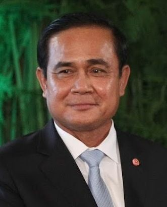 Government: Thailand is a constitutional monarchy. What that means is that the country has both a Prime minister who is the head of government and A king who has no power but is the head of state. The Prime minister, as you can see from the picture above is, Prayut Chan-o-cha.  All prime ministers are appointed by the Thai house of representatives with at least 50% of the vote and then sworn in by the king.