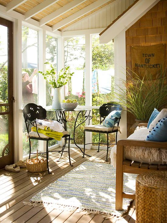 Make the most of a small porch with slender furniture. A small bistro table-and-chairs set adds functional seating to this home's casual porch, while not overwhelming the tiny space like a larger set would./