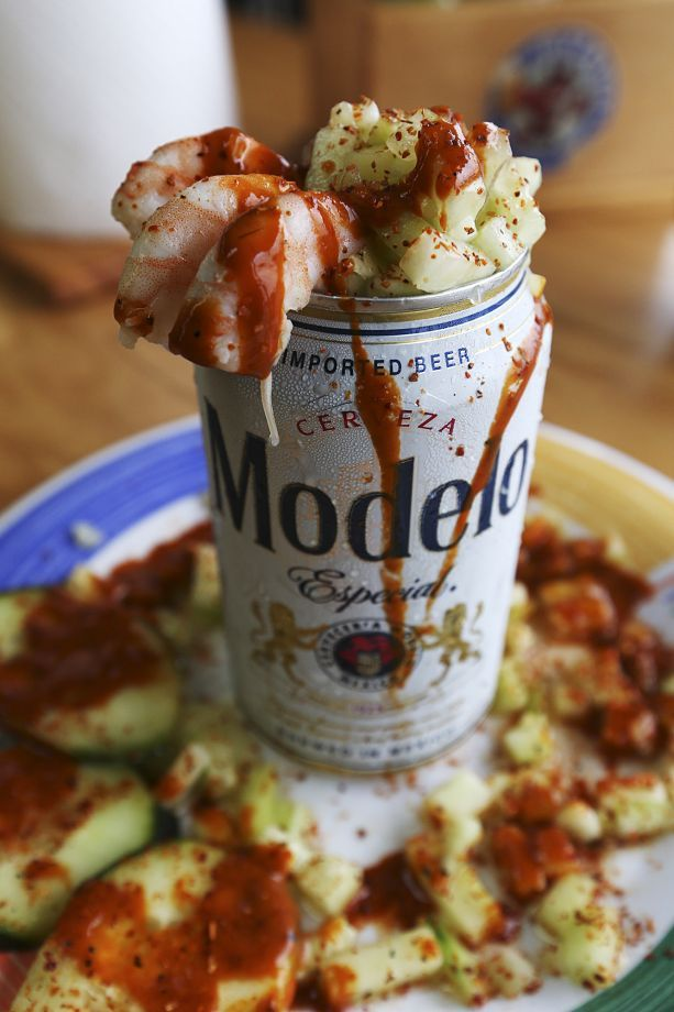 The cerveza preparada comes with shrimp, cucumbers and a hot sauce at Las Islas Marias Mexican seafood restaurant. Photo: Jerry Lara /San Antonio Express-News / © 2015 San Antonio Express-News