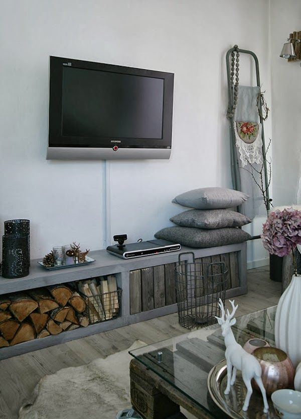 TV Display in the living room and fire wood storage in Norwegian home