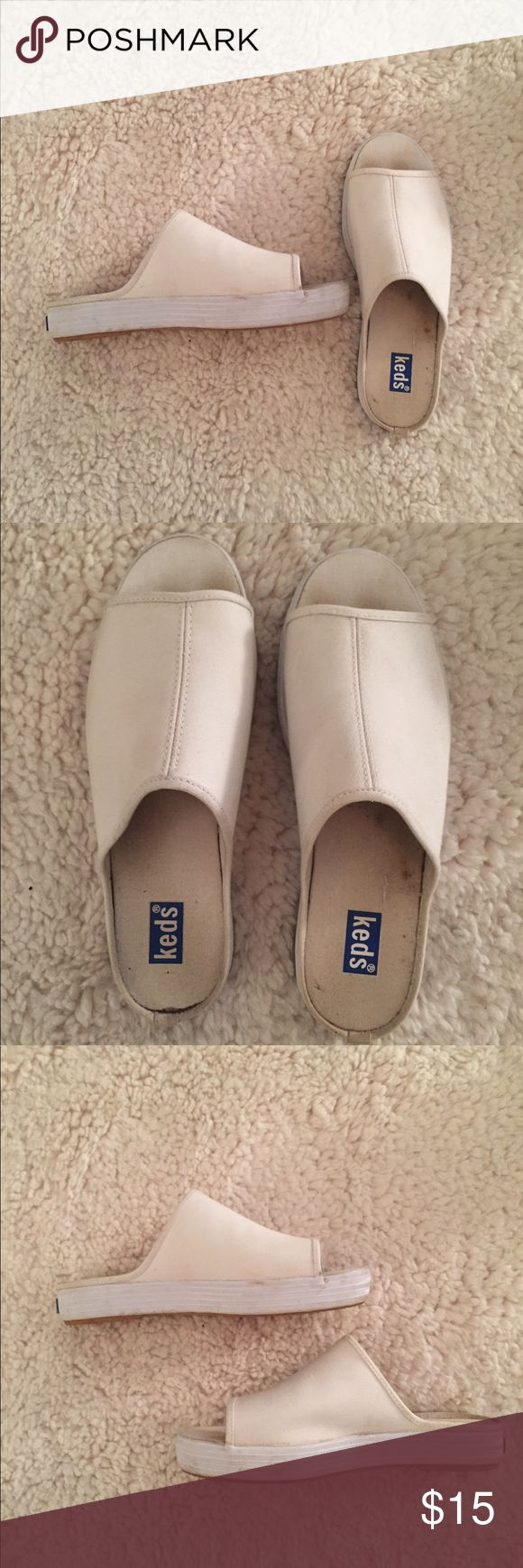 White Keds slip-ons Cute kids slip-ons, only worn twice but there is some visible wear inside the shoe, as pictured. Almost none on outside! Keds Shoes Sandals