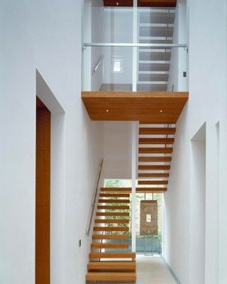 Multi-flight timber staircase cantilevered off of walls. Via McLean Quinlan