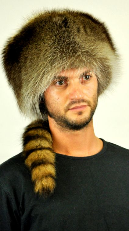 "This authentic ""coonskin cap"" fits both men and women. Real raccoon fur hat with true tail. Perfect to flaunt your own style even in winter. Handmade fur hat.  www.amifur.com"