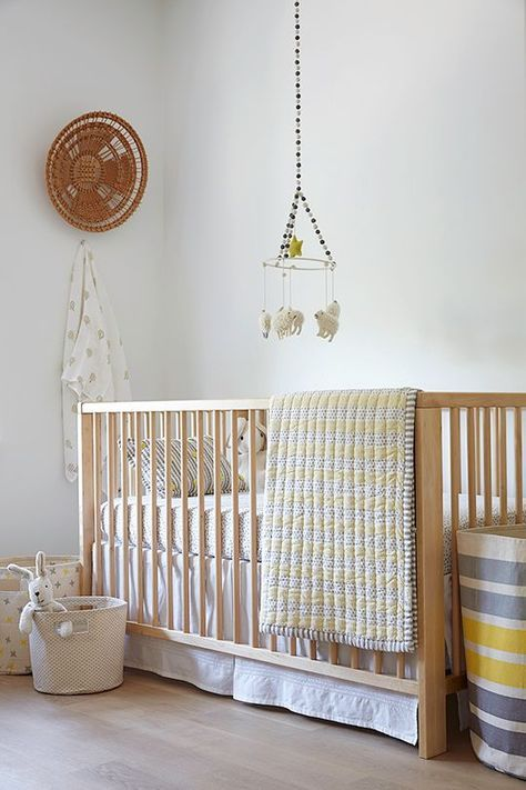 natural wood crib with baskets in every size