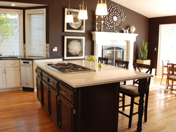 Like the chocolate brown wall color with the stark white contrast of the wall/door frames. Could see this with neutral colored furniture in tan and a pop of bright color.