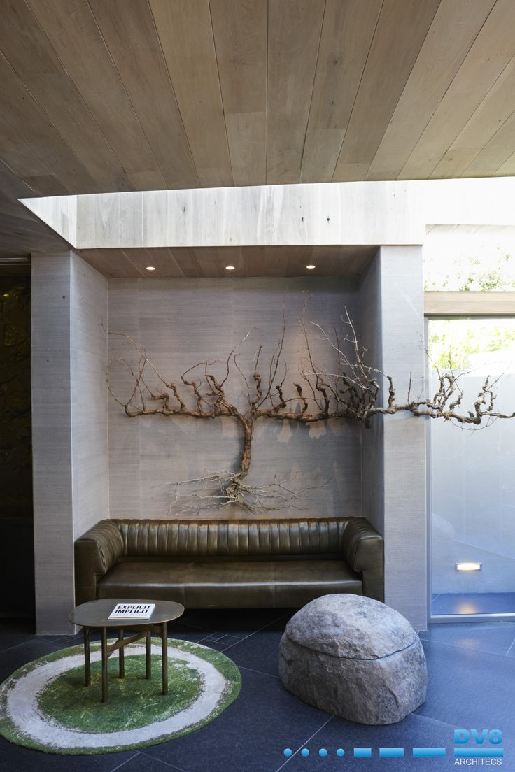 Ellerman House Wine Gallery. The informal lounge with light pouring in from skylight above. Vine sculpture by Nic Bladen