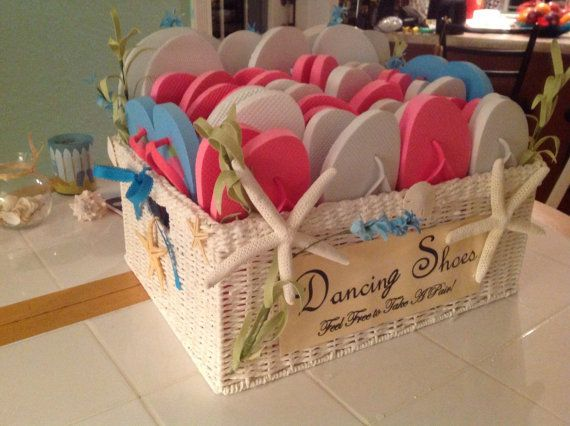 Beach Dancing Shoes Basket- Spoil your guests with flip-flops to dance the night away. Made to order. on Etsy, $300.00