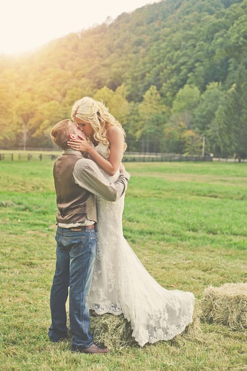 This is EXACTLY what I'm shooting for! Guys in jeans and vests and me in a gorgeous lace gown....sigh....love!