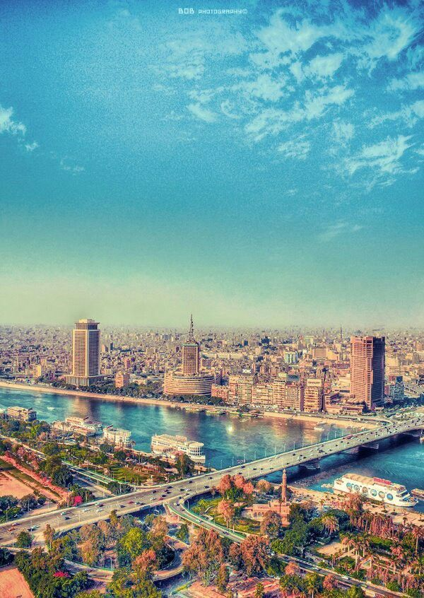A lovely shot of Cairo taken atop the Cairo tower on the island suburb of Zamalek. Across the Nile is the area known as Maspirou, the landmarks of which are the Trade Centre (left), the iconic Cairo TV building (middle) and the Ramses Hilton (right).