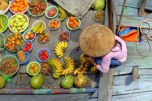 Halong Bay fruit seller by Andrew Hux, via Flickr