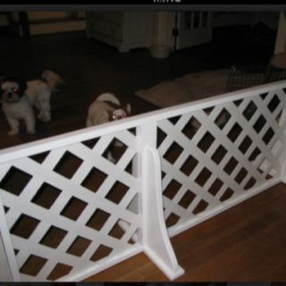 use long shelf brackets and plastic lattice panels and piano hinges for cheap dog fence around