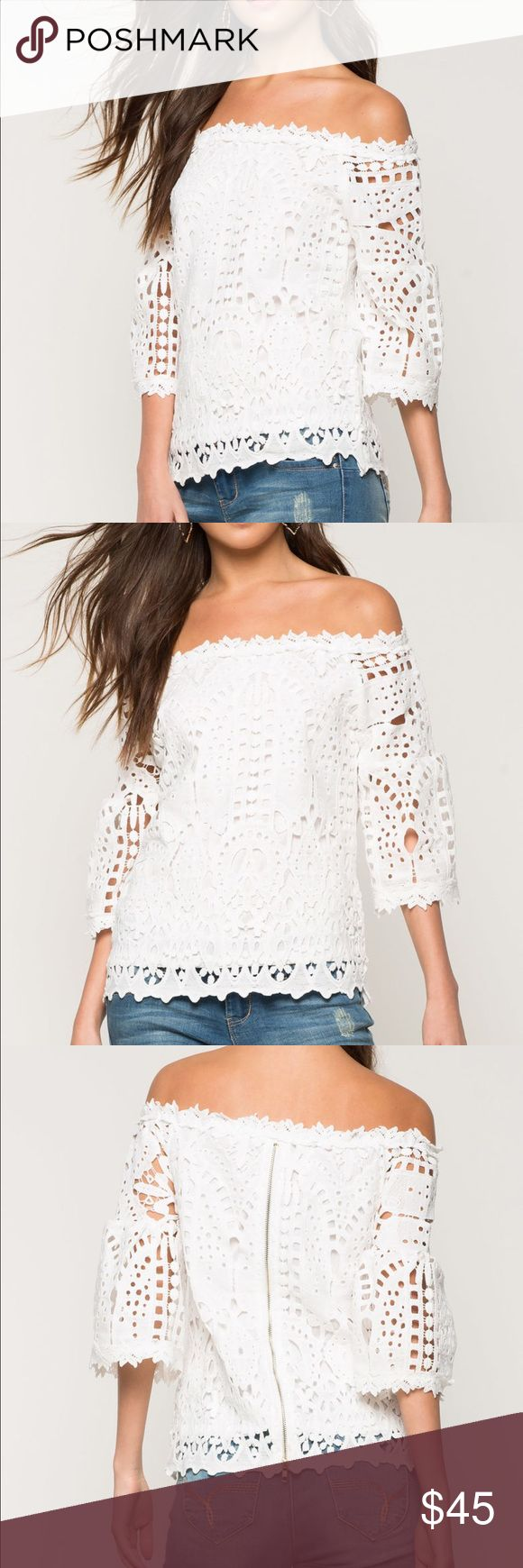 White crochet lace off shoulder bell sleeve top L A knit crochet top with scalloped trim, an elasticized off-the-shoulder neckline, and 3/4 bell sleeves. Partially lined. Finished seams. Exposed back zipper. The flared trumpet sleeves and quality crochet on bright white make this Blouse the top for summer. Similar in style and quality to for love or lemons or lovers and friends, this piece is a statement. Pair with jeans or cut offs for festival season, or dress it up with black pants and…