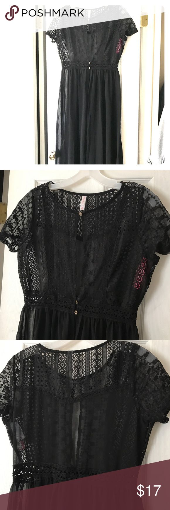 Black Crochet Top Flyaway Summer top Black short sleeves, top with 3 cute gold buttons, crochet detailing. Bottom is sheer with flyaway look. Super cute with tank and crops, maybe a pair of heels!! Xhilaration Tops Blouses