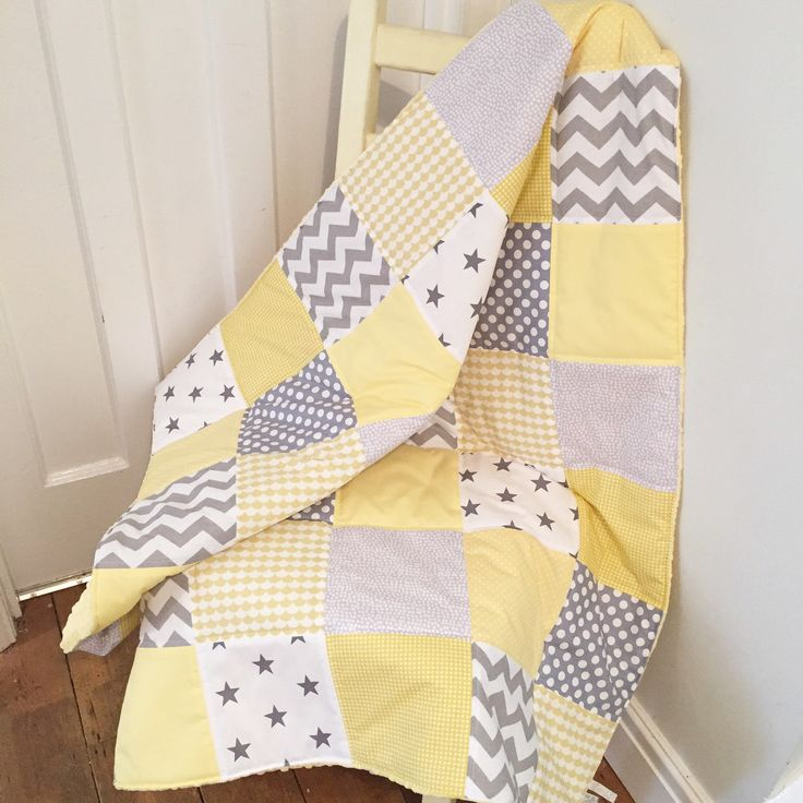 A custom creation patchwork baby blanket. Gorgeous grey and yellow combination. Perfect for a unisex nursery.
