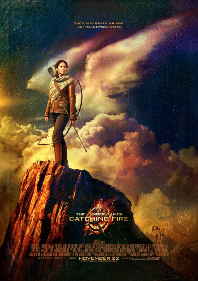 """The sun persists in rising, so I make myself stand.""  The all-new Catching Fire poster...i love it!!!!"