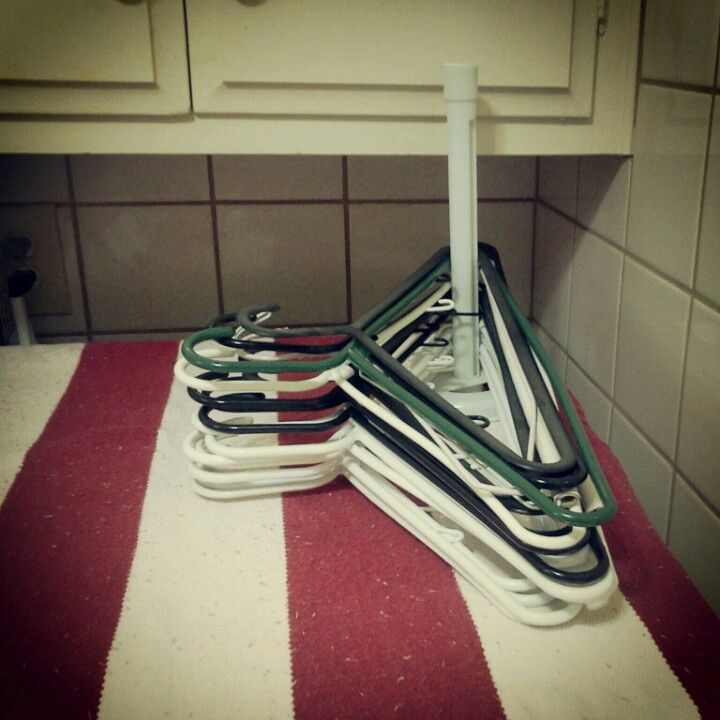 Use A Paper Towel Holder For Storing Hangers In The