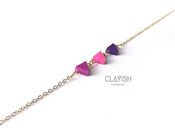 This beautiful combination of purple colour triangle polymer clay will definitely make your simple outfit stand out! Available in purple, however custom order is welcome too! Beads Materials: Polymer Clay Bead Colour: Purple Chain Materials: Copper Chain Colour: Gold/SIlver Length: 51.5 cm Every piece of the clay is carefully shaped and completed by hand, therefore each of them is unique and there might be little imperfections or occasional fingerprints.