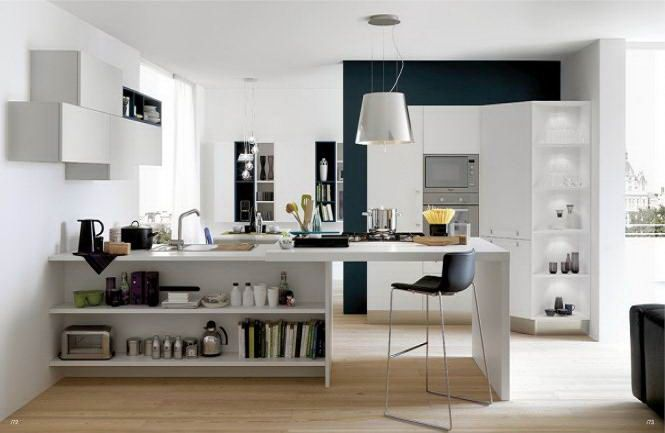 open kitchen in white with wooden flooring