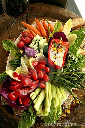 Vegetable platter w/ tomatoes, asparagus, celery sticks, red peppers .. love the dip served in the red bell pepper