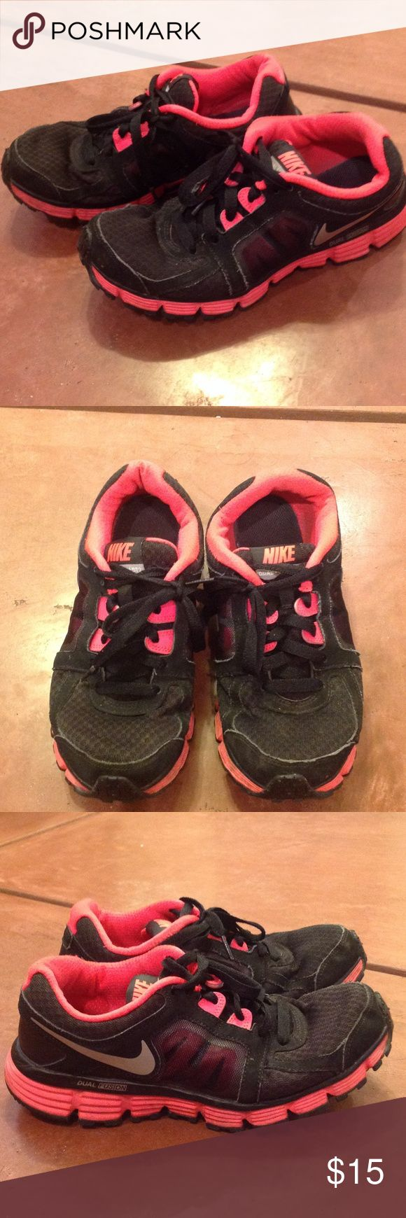Hot Pink and Black Nike Tennis Shoes Size 7 Wore these for work, so they are definitely used but still in good condition. Nike Dual Fusion tennis shoes. Size 7. All rubber still intact. Smoke free pet free home. Very comfy for work or running. Make an offer! Nike Shoes Athletic Shoes