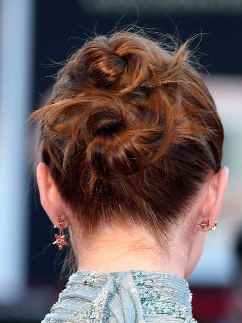 Emma Stone's hairstylist created this red carpet look by splitting her hair into two even parts and stacking them on top of each other as two ponytails. She then twisted them into loose buns to complete Emma's 'do.