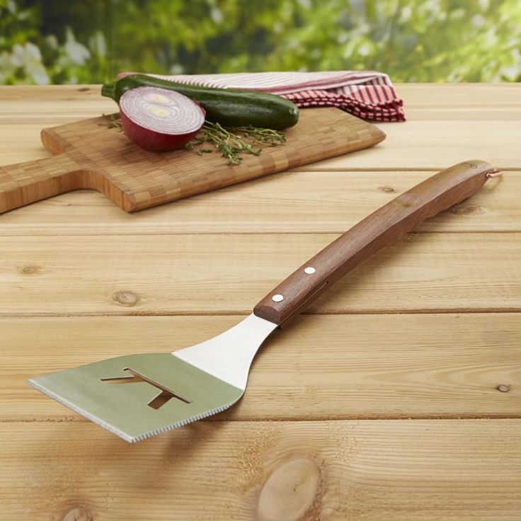 Flip your burgers, steak or other delicious BBQ food with the Outset BBQ Rosewood Handle Spatula.