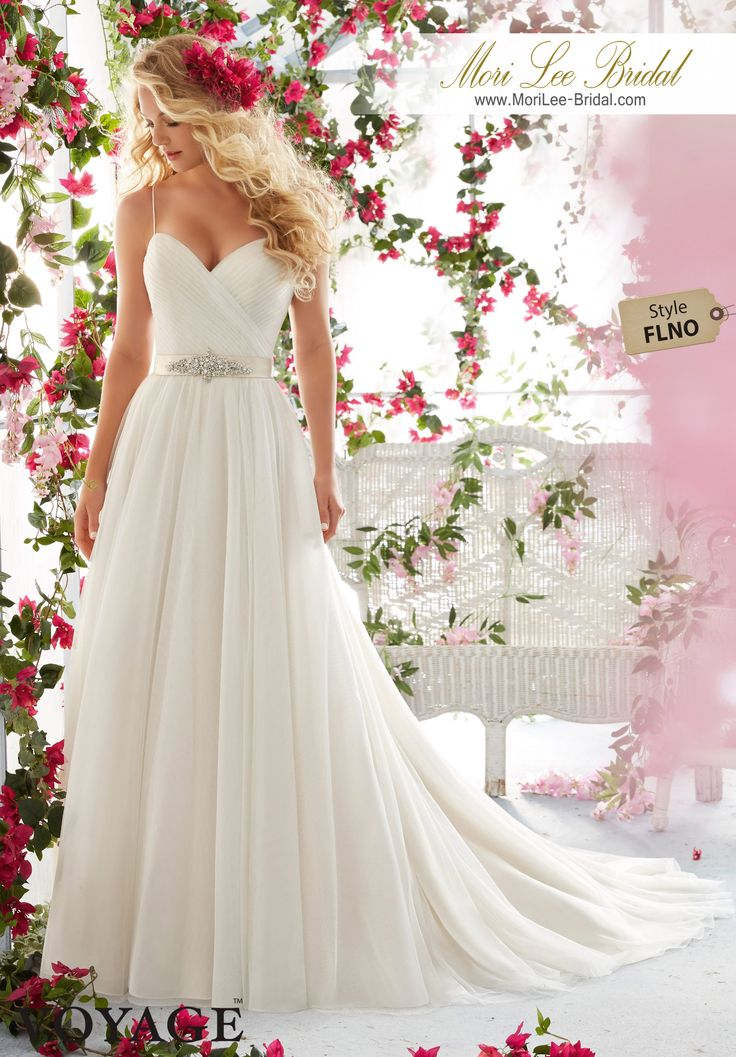 Dress Style FLNO   Asymetrically Draped Bodice With Shoestring Straps On Soft Net Gown  Removable Beaded Satin Belt. Colors available: White, Ivory, Ivory/Light Gold, Ivory/Blush