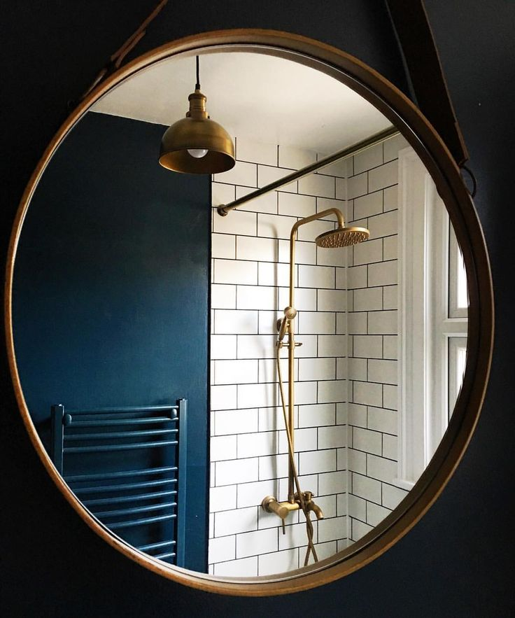 Farrow and Ball 'Hague Blue' walls with copper pipes in shower room