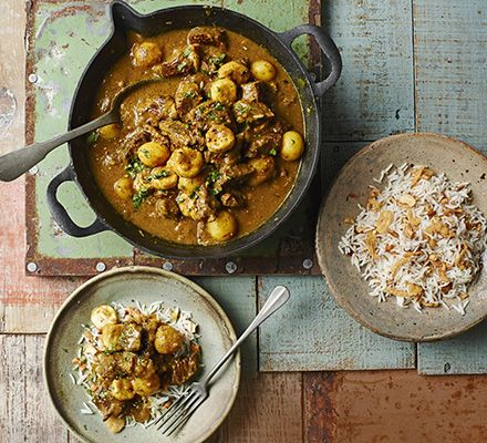 Banana and tamarind add a rich sweetness to this slow-cooked spice pot with nutty basmati and coconut sauce