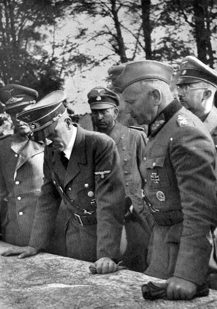 Hitler in Poland by Heinrich Hoffmann -- From left: Bodenschatz, Hitler, unknown, Reichenau and Himmler.