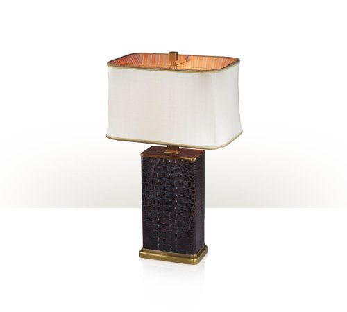 A Kalahari table lamp, the box shaped body with brass base and mounts surmounted by a hand sewn silk box shade. The original Art Deco.