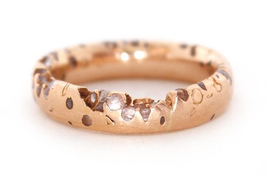 40 AWESOME Wedding Bands To Fit Your Style #refinery29  http://www.refinery29.com/cool-wedding-bands#slide-30  The raw, eroded finish of this band reveals white sapphires of different sizes that seem haphazardly cast within.
