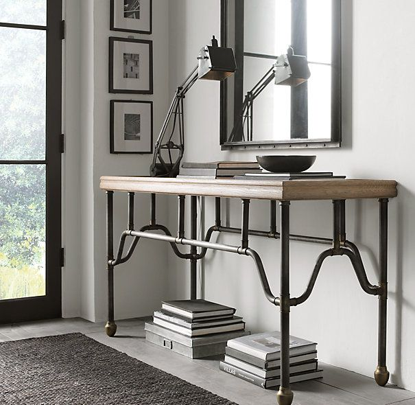 Inspired by a circa 1900 Belle Epoque French bistro table, our reproduction captures its graceful, if not whimsical, base of workaday water pipes supporting a wood plank top. Elegant in its composition, the unique design features burnished brass t-joints and acorn feet.   Iron water pipes joined with solid brass fittings create a table base with Belle Epoque lines