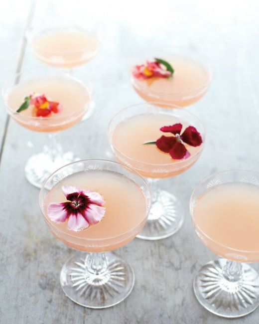 Lillet, Rosewater & Ruby Red Grapefruit wine cocktail with edible flowers. Gorge.