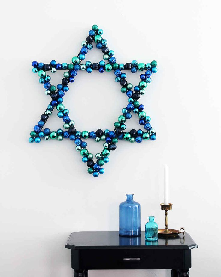 Hanukkah Ornament Wreath Holiday Decor Ideas | Martha Stewart Living — To create this wreath, start with a simple Star of David shape made from wooden paint sticks.