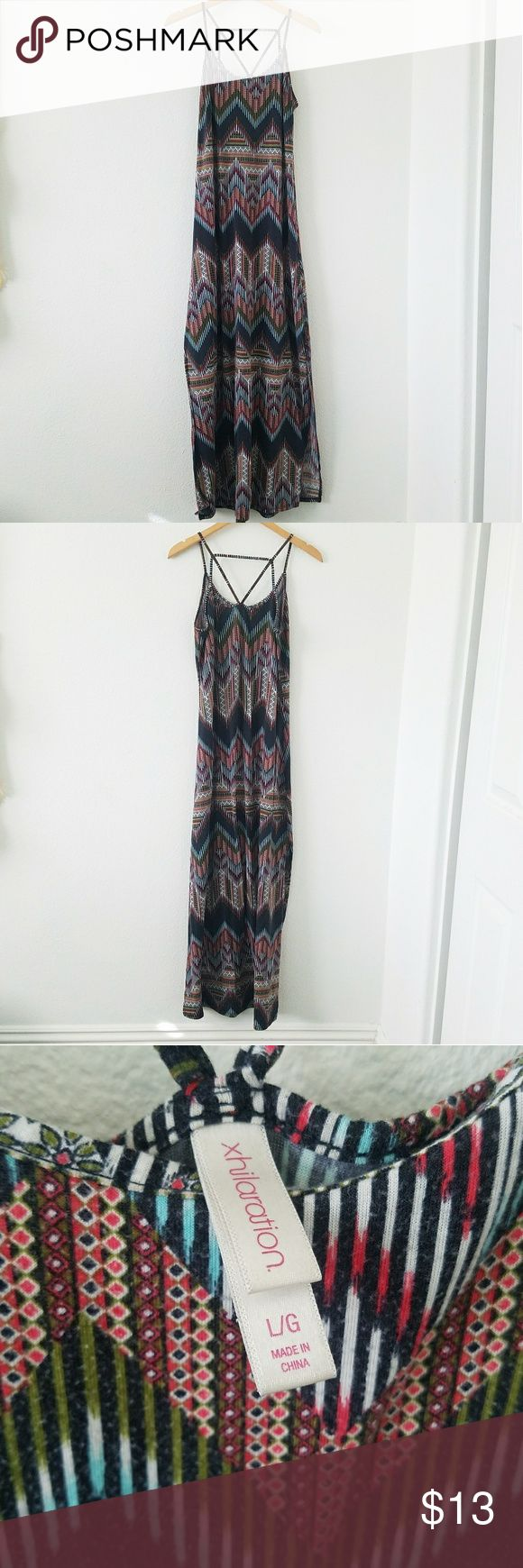 Tribal Maxi Dress This dress features beautiful tribal pattern, two long slits on the side and beautiful straps on the back. This dress is an overall good used condition. There is a lot of piling throughout the dress because of its material. Xhilaration Dresses Maxi