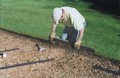 "A man installs Everedge with ease. Comes in 3 different sizes. Choose from 3"", 4"" and 5"" depths. #gardening #lawnedging"