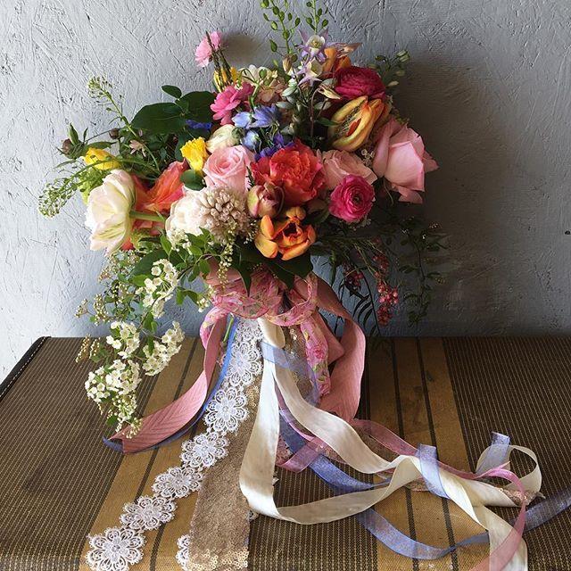 Bridal bouquet of French tulips, garden roses, ranunculus, spirea, and snowball bush. #iowaflorist #clarasgardenmepo #weddingswithclarasgarden #weddingseason2017 #southeastiowaflorist #underthefloralspell #prettypretty