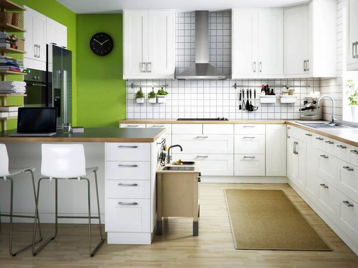 This must have been staged by IKEA. Love the play kitchen! Wall color, cabinet, backsplash great. Could use darker wood tone, more grey.